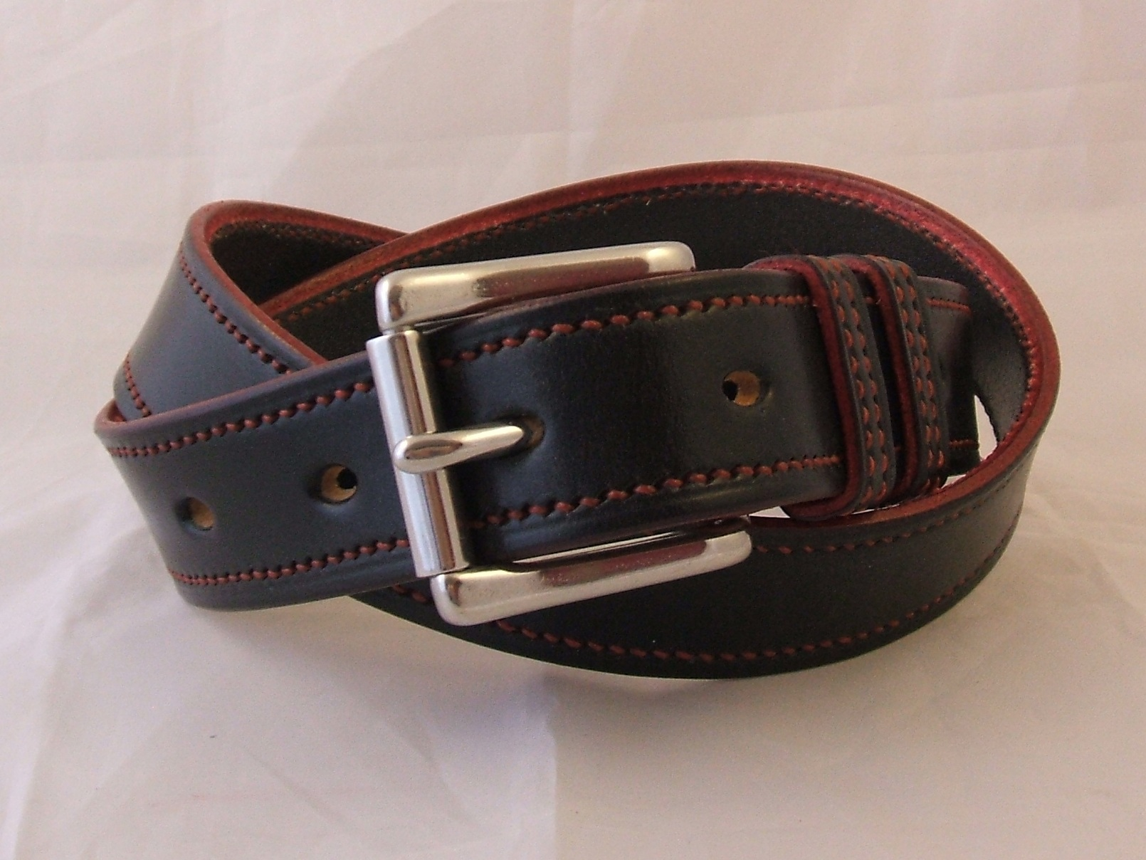 Border Belts; handstitched, a number of hours' painstaking work